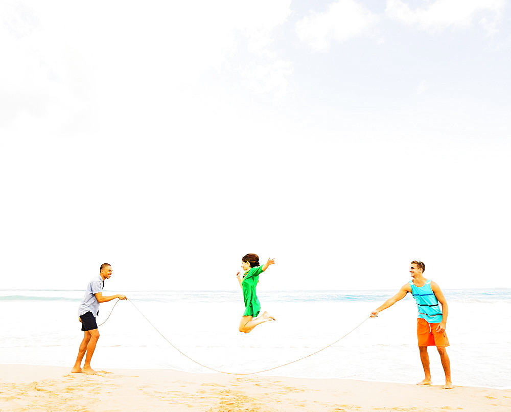 Young people playing on beach, Jupiter, Florida