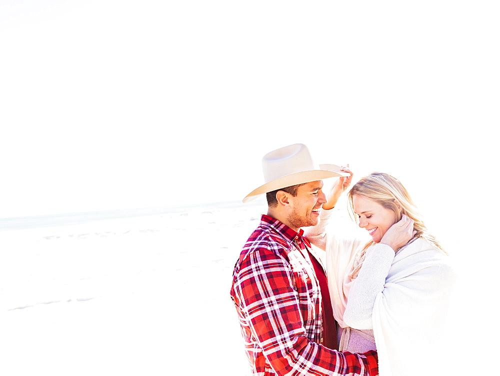 Smiling couple on beach, Jupiter, Florida
