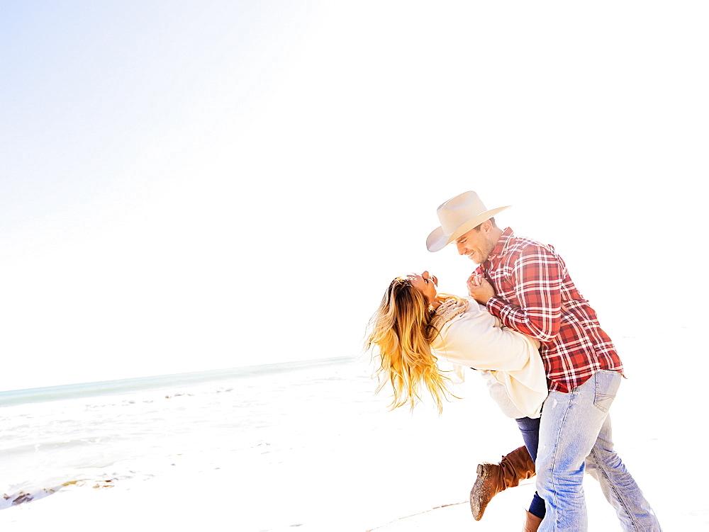 Loving couple on beach, Jupiter, Florida