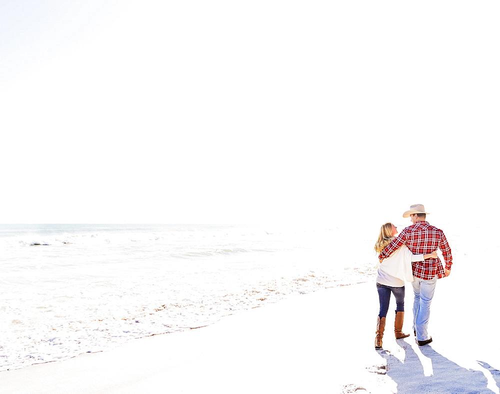 Couple walking on beach, Jupiter, Florida