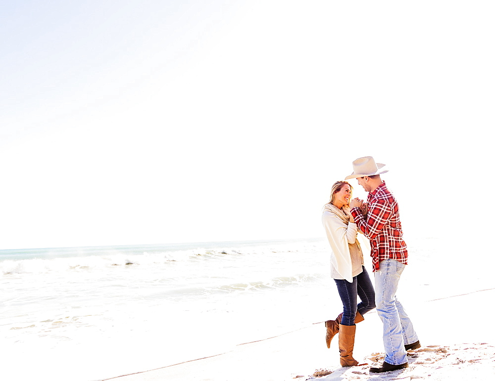 Loving couple dancing on beach, Jupiter, Florida