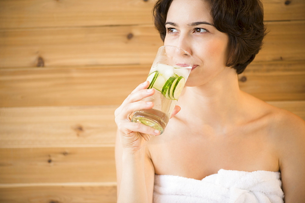 Woman drinking water in spa
