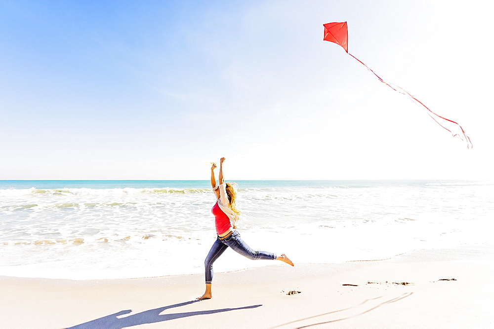 Woman on beach with kite, Jupiter, Florida