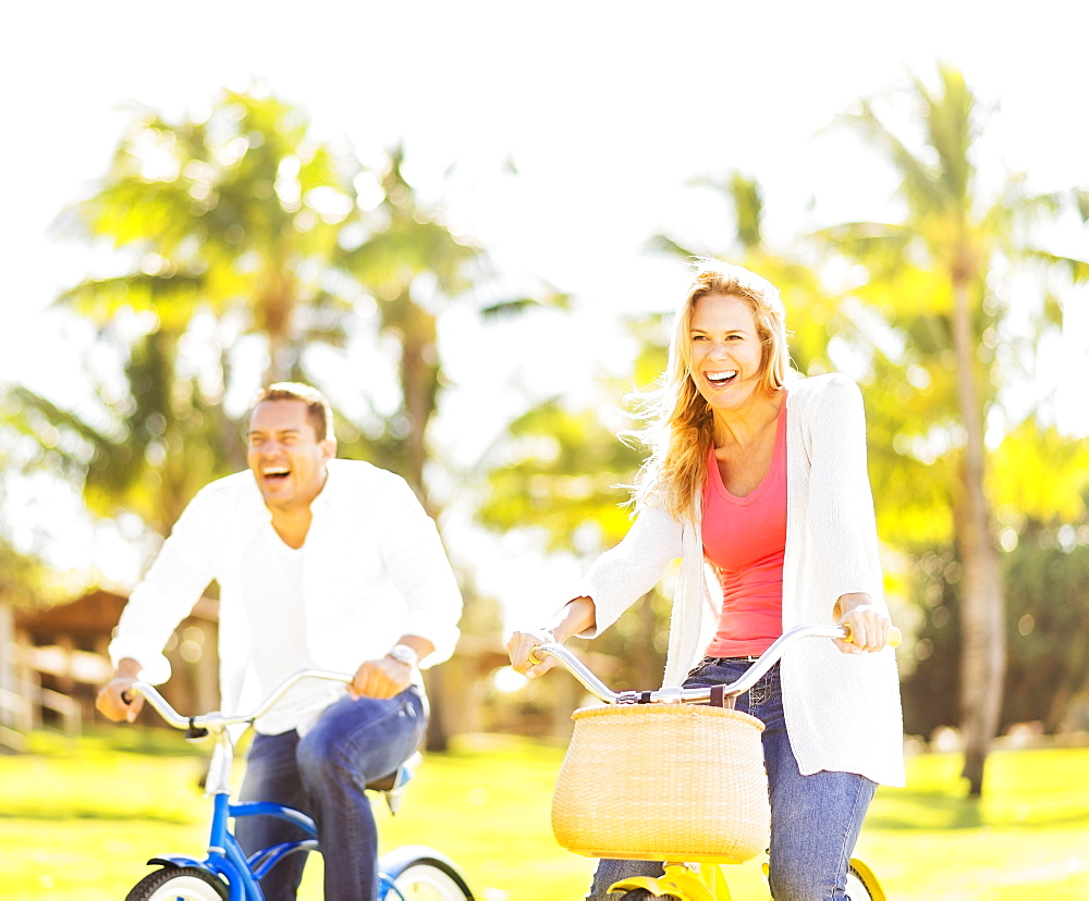 Couple riding on bikes, Jupiter, Florida