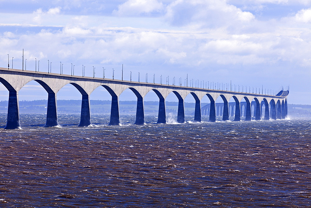 View of long concrete bridge over strait, Prince Edward Island, New Brunswick, Canada