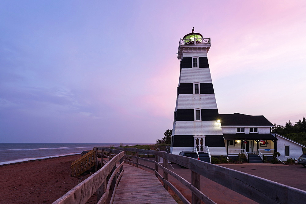 West Point Lighthouse and sandy beach at dusk, Prince Edward Island, New Brunswick, Canada