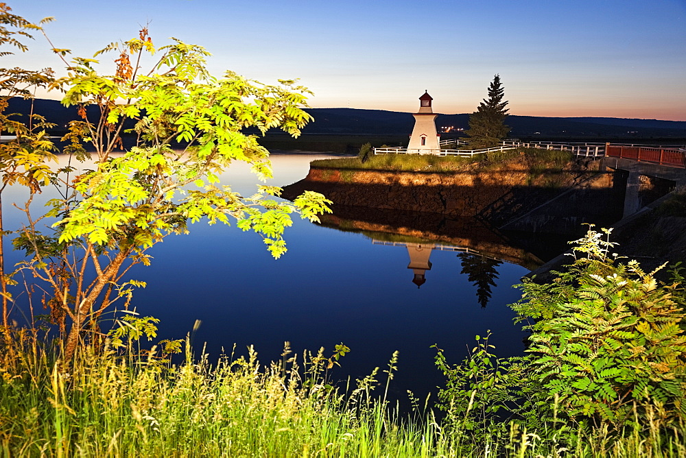 Anderson Hollow Lighthouse by pond at dusk, New Brunswick, Canada