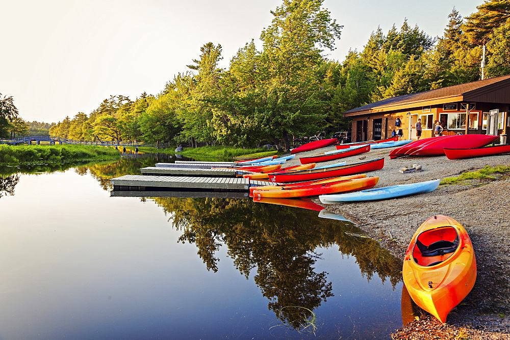 Kayaks on lakeshore, Nova Scotia, Canada
