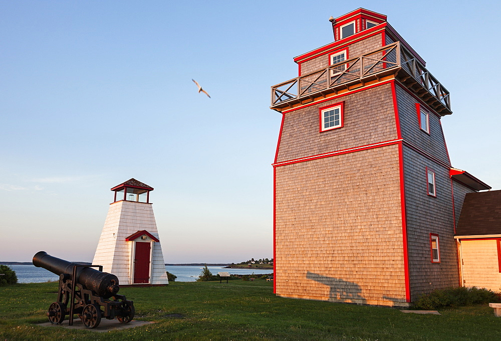 La Have Lighthouse and cannon on shore, Nova Scotia, Canada