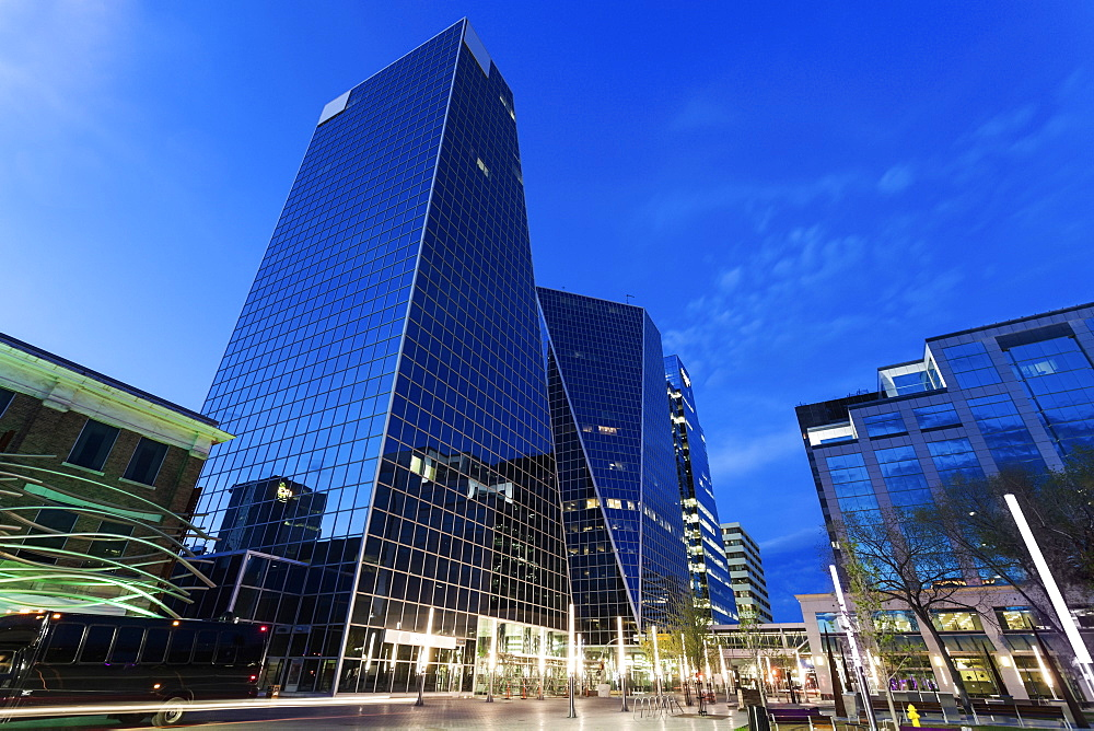 Low angle view of city street with glass skyscrapers, Canada