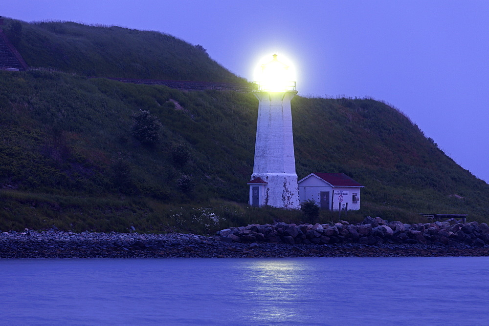 Georges Island Lighthouse on rocky coast at dawn, Nova Scotia, Canada