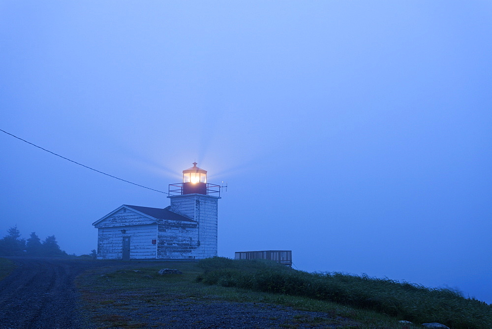 Port Bickerton Lighthouse in fog at dawn, Nova Scotia, Canada