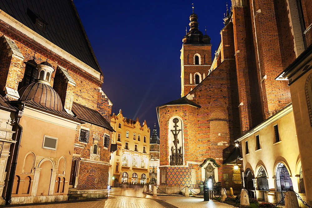 Street-level view of illuminated St. Barbara Church, Poland