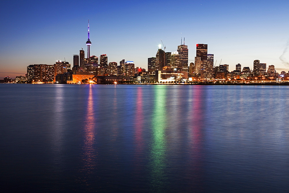 Illuminated skyline seen from lake, Toronto, Canada
