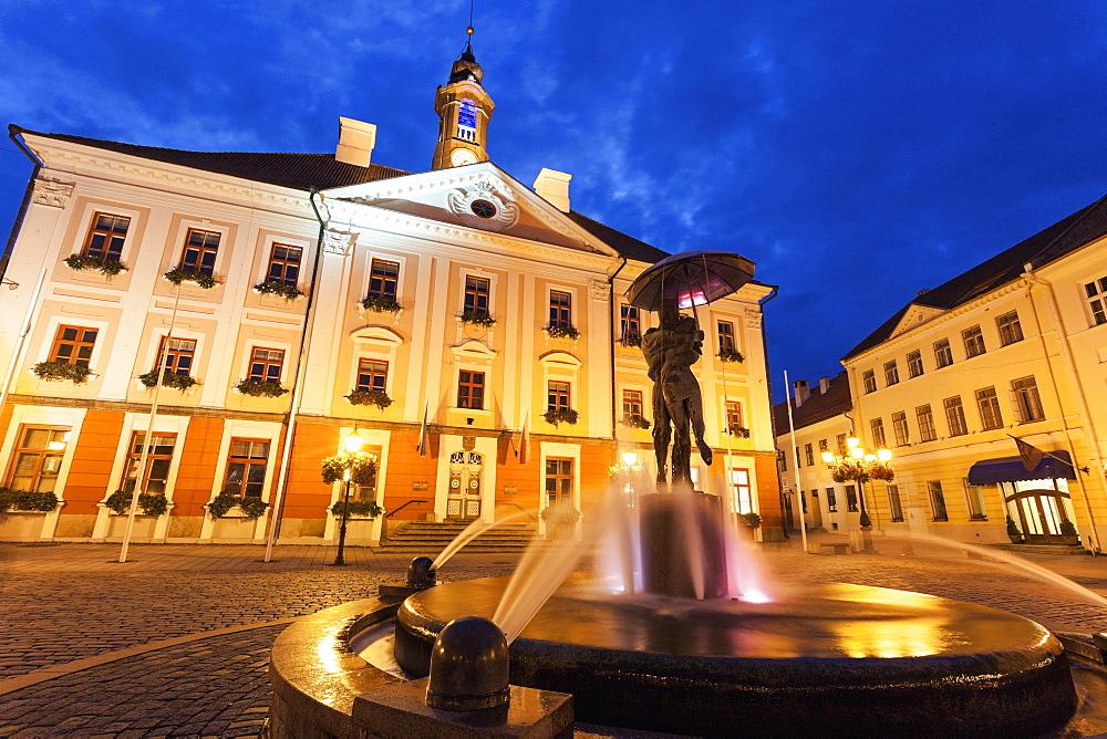 Kissing Students Fountain against illuminated building, Estonia - 1178-24157