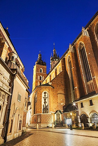Street-level view of illuminated St. Barbara Church, Poland