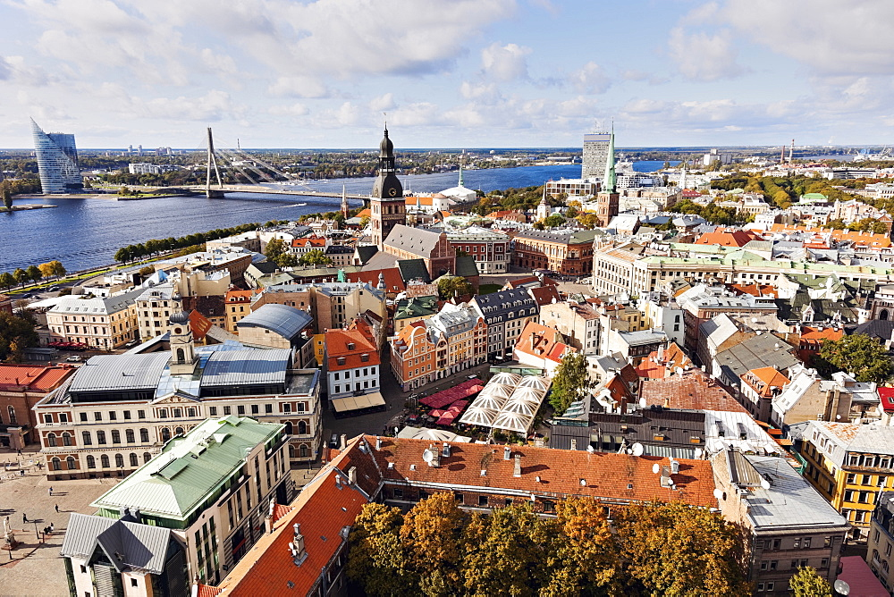 Cityscape of old town and river in distance, Latvia