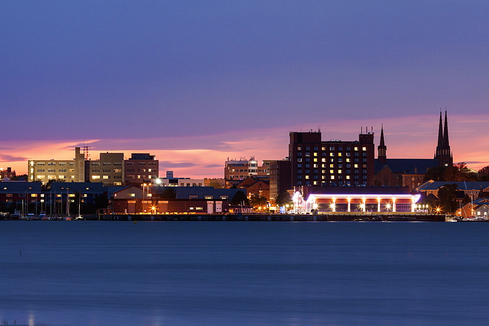 Illuminated waterfront skyline against moody sky, Prince Edward Island, New Brunswick, Canada