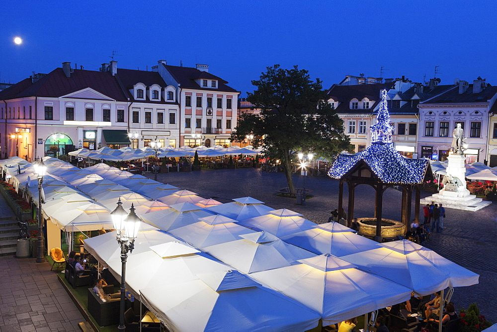 High angle view of market square at night, Poland