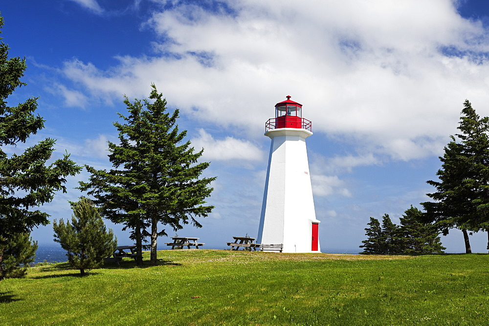 Cape George Lighthouse on grassy hill, Nova Scotia, Canada