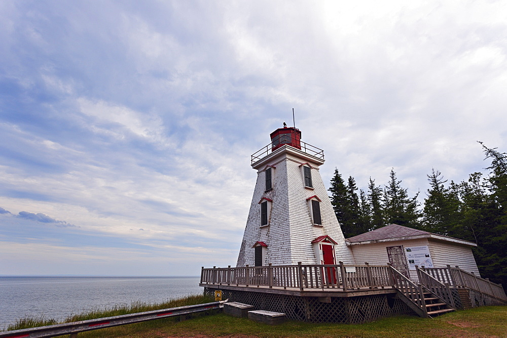 Cape Bear Lighthouse under cloudy sky, Prince Edward Island, New Brunswick, Canada