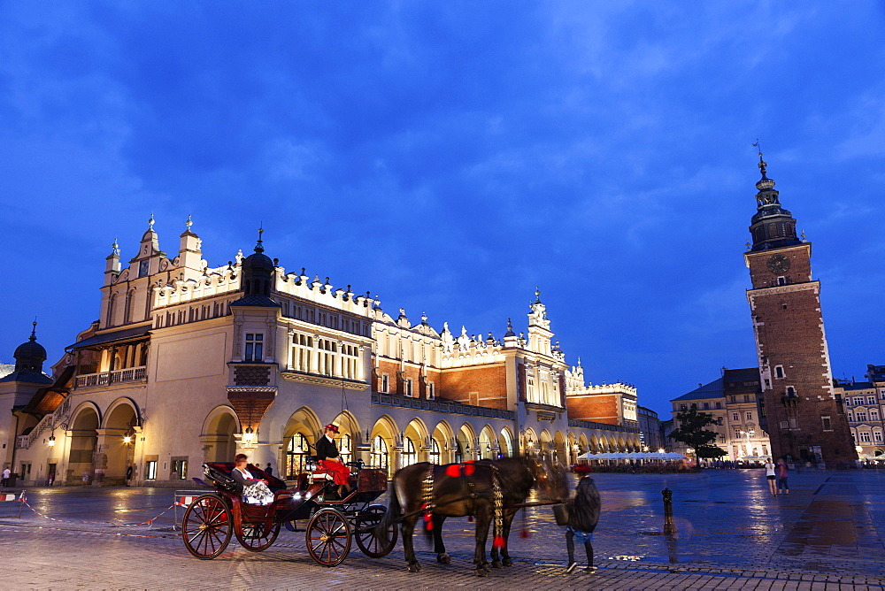 Horse cart against Cloth Hall on main square, Poland