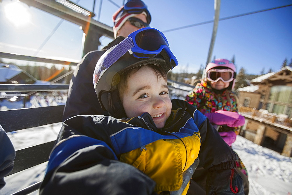 Father skiing with children (6-7, 8-9), Whitefish, Montana USA
