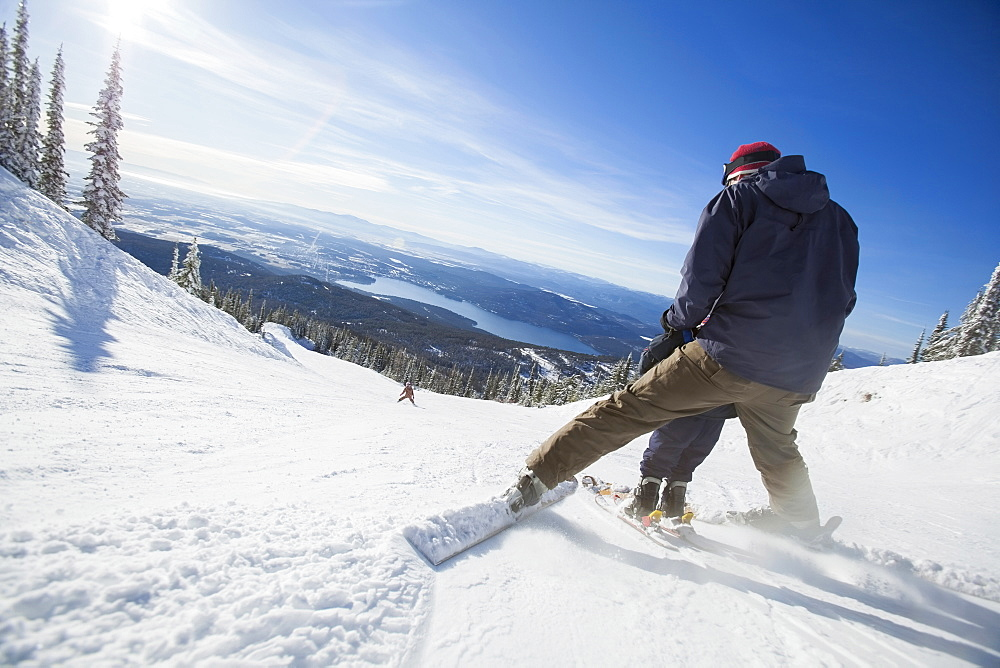 Father skiing with son (6-7), Whitefish, Montana, USA
