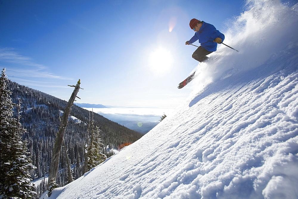 Man skiing in mountains, Whitefish,Montana,USA