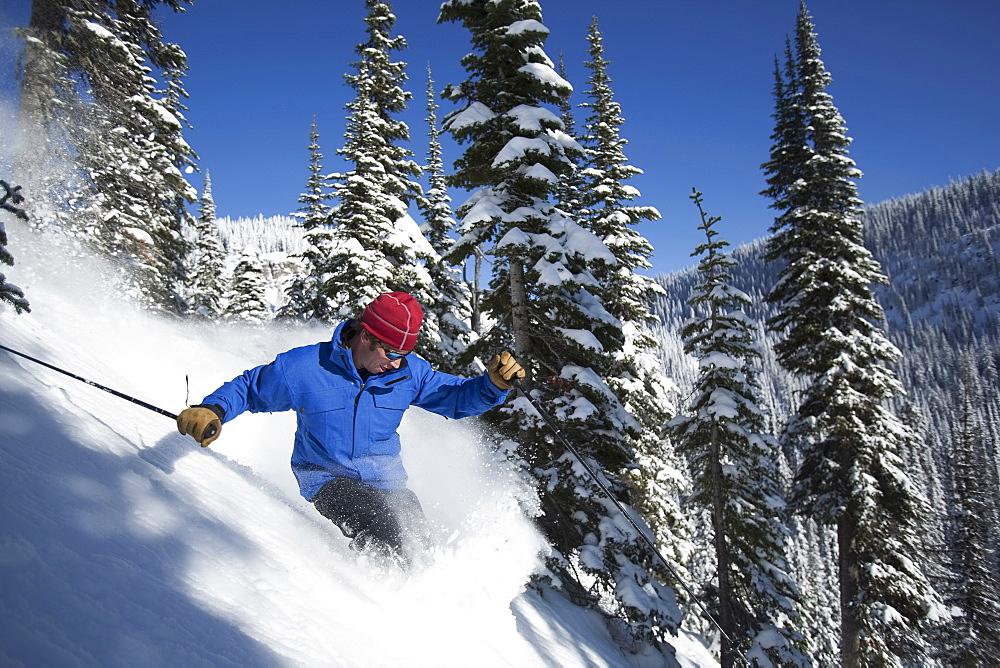 Man skiing in mountains, Whitefish, Montana, USA