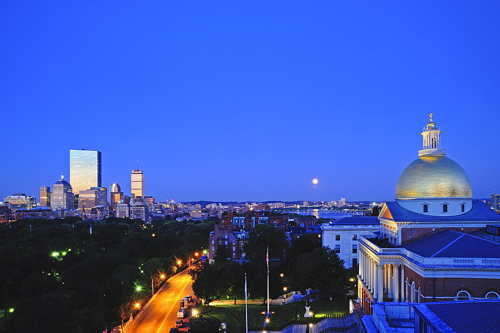 View of Massachusetts State House Dome and city skyline at moonrise, Boston, Massachusetts