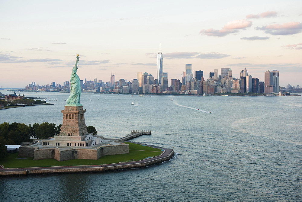 Aerial view of Statue of Liberty and city skyline, New York, New York