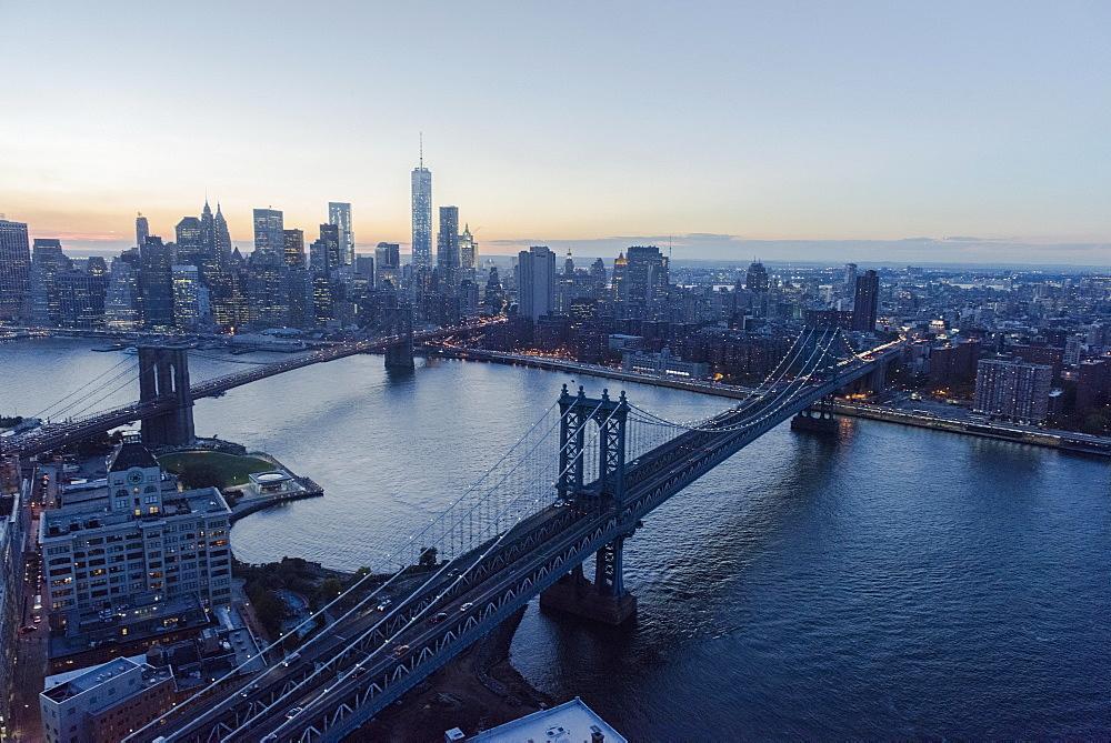 Lower Manhattan, View of Brooklyn Bridge and One World Trade Center at dusk, New York, New York