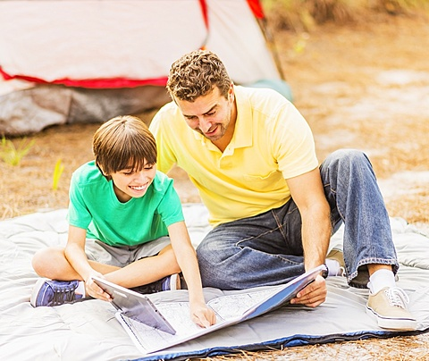 Father and son (12-13) camping, Jupiter, Florida