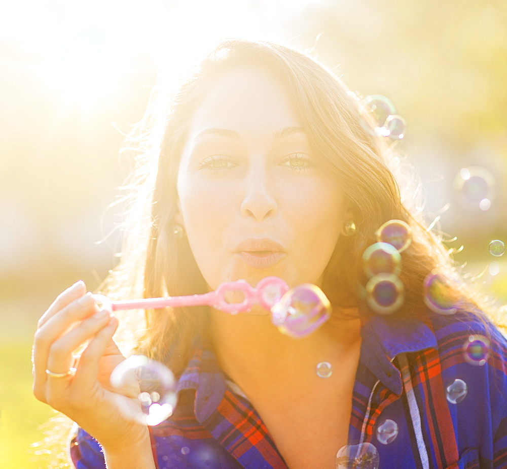 Woman blowing bubbles, Jupiter, Florida