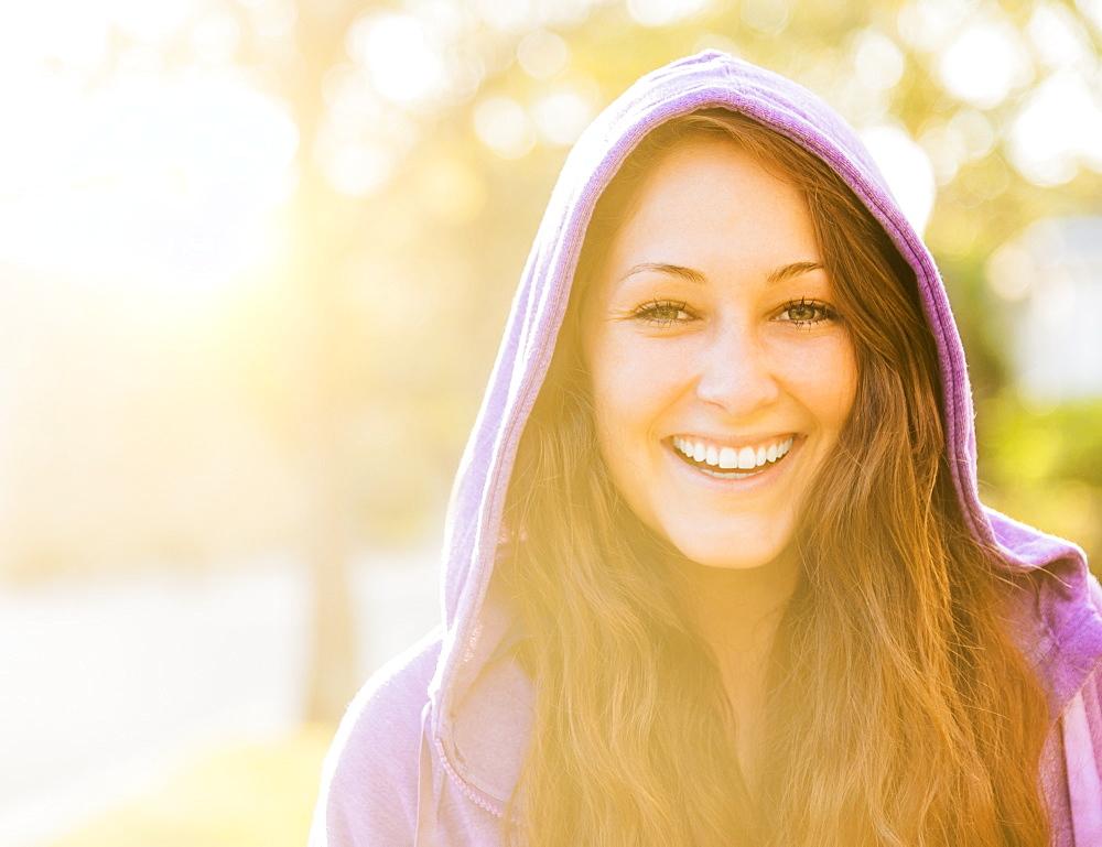 Portrait of smiling woman in hoodie, Jupiter, Florida
