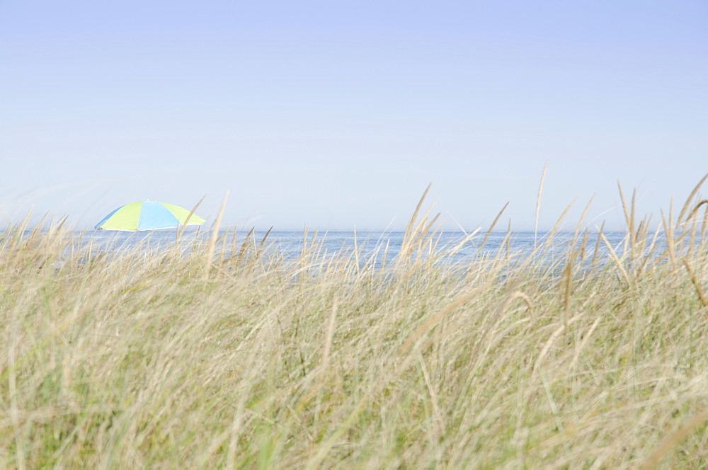 View of beach umbrella by sea, Nantucket Island, Massachusetts, USA
