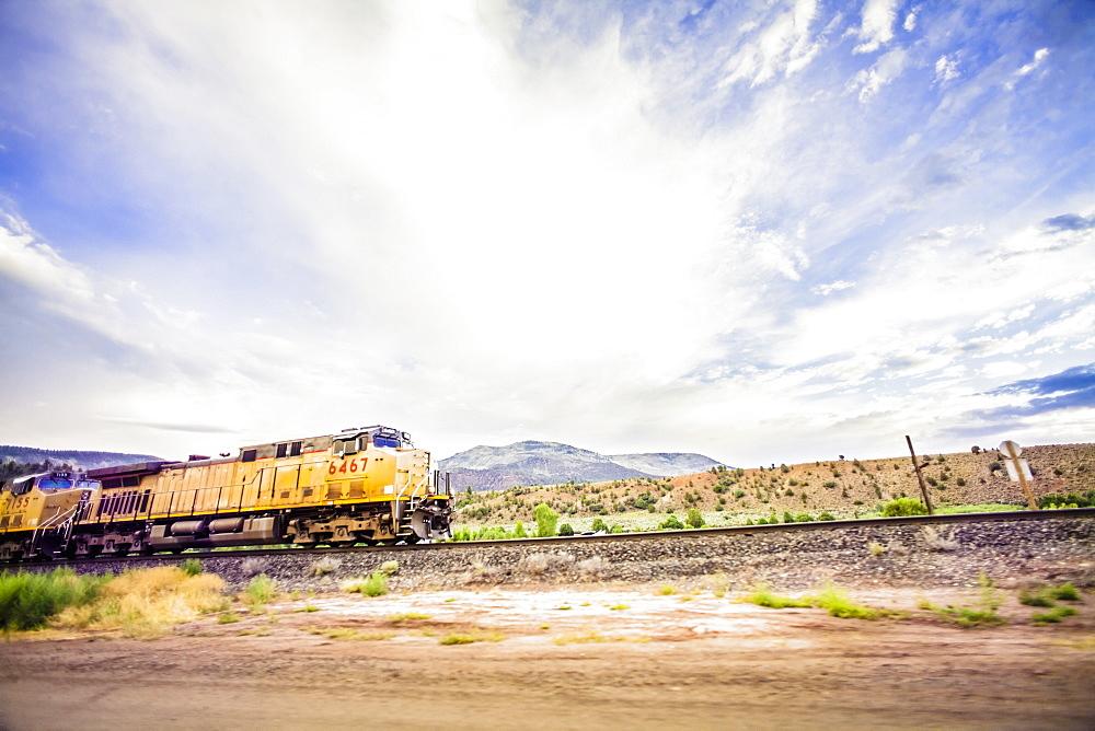 Train on railroad tracks in countryside, Colorado