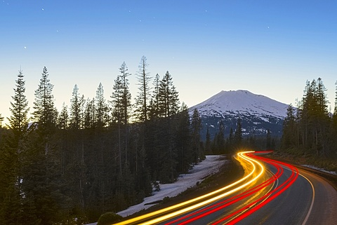 View of light trail on road in forest, Mount Bachelor, Oregon