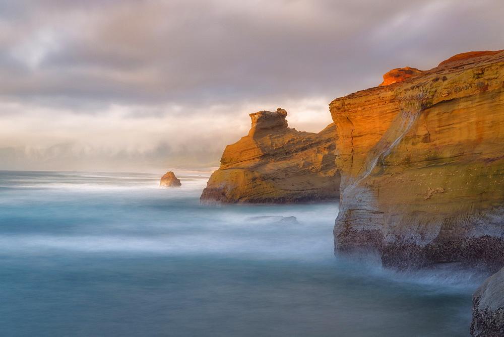 Scenic view of cliffs along coastline, Cape Kiwanda, Oregon
