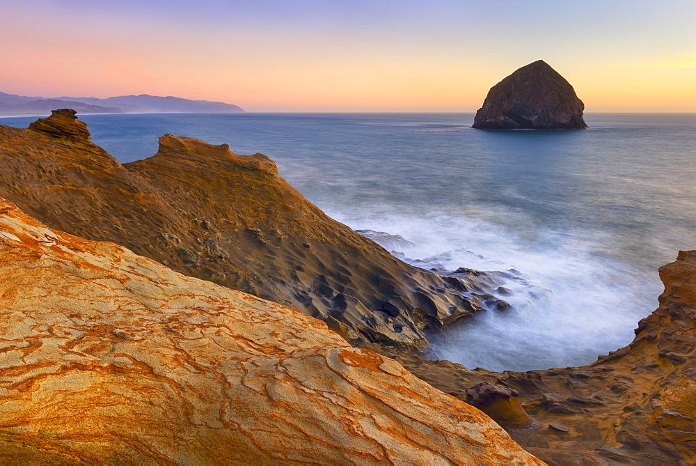 Scenic view of rock formations along coastline, Cape Kiwanda, Oregon