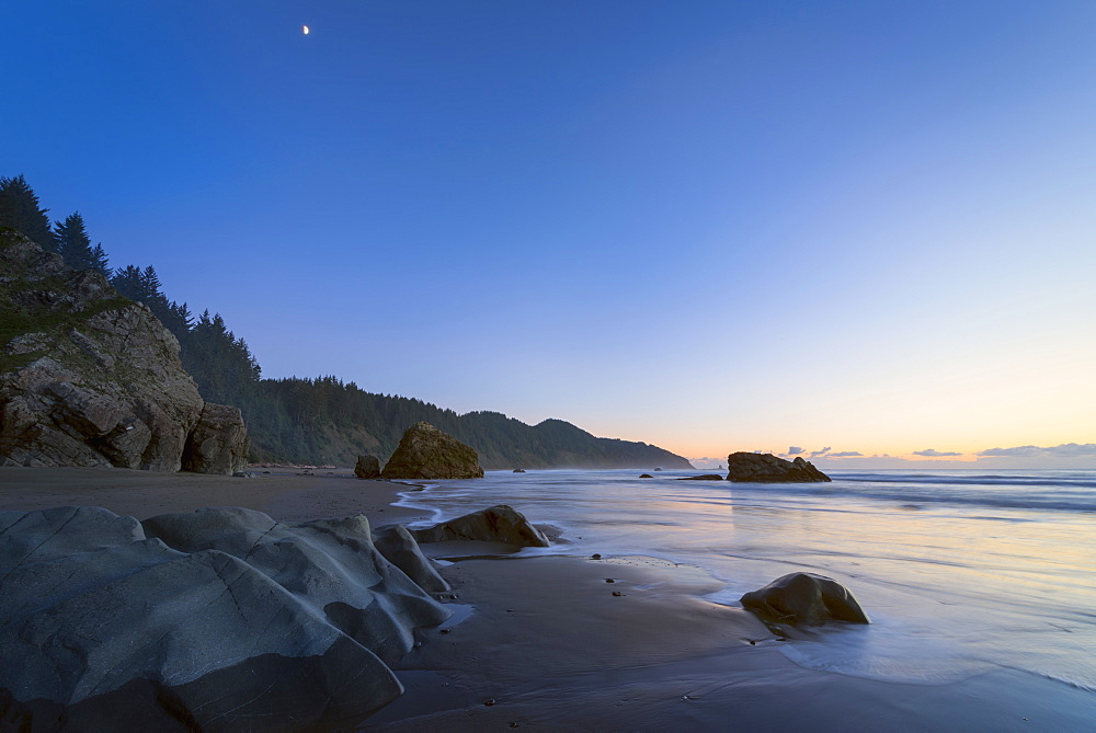 Scenic view of coastline at sunset, Whales Head Beach, Oregon