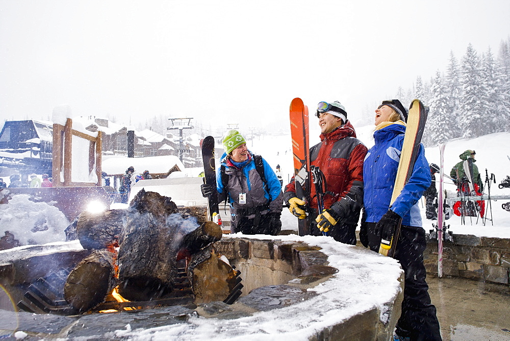Group of friends with bonfire in winter, Whitefish, Montana, USA