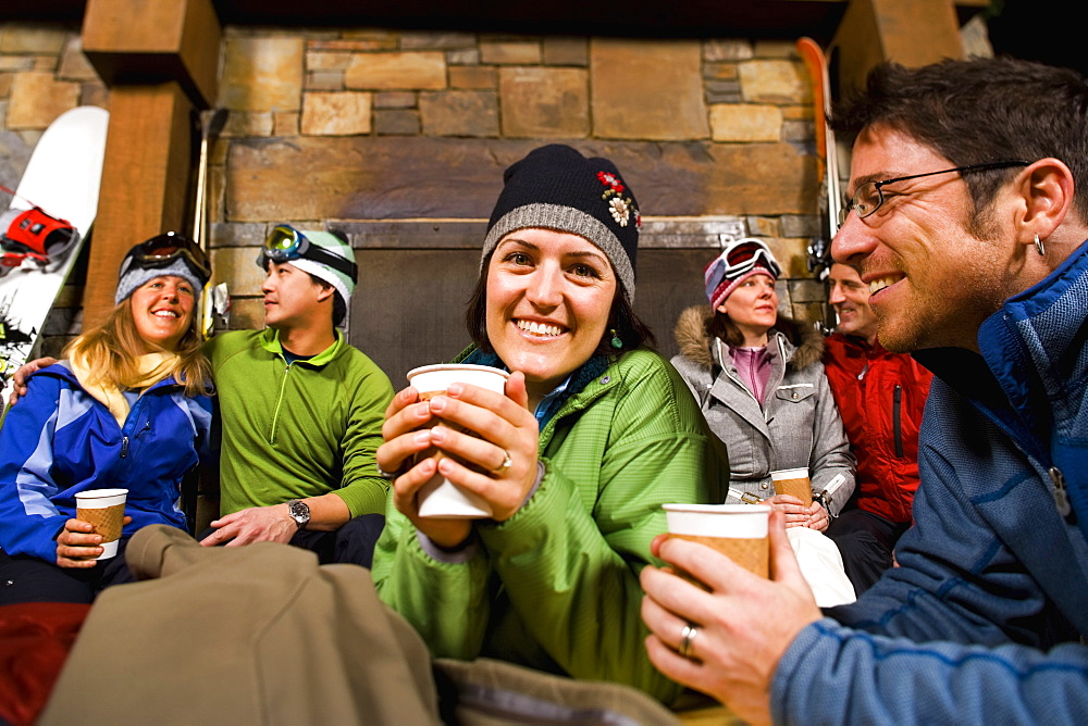 Group of skiers hanging out at fireplace, Whitefish, Montana, USA