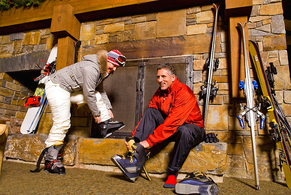 Skier putting on ski boots, Whitefish, Montana, USA
