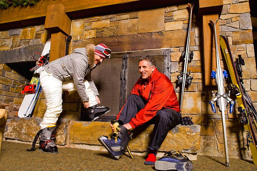 Skier putting on ski boots, Whitefish, Montana, USA