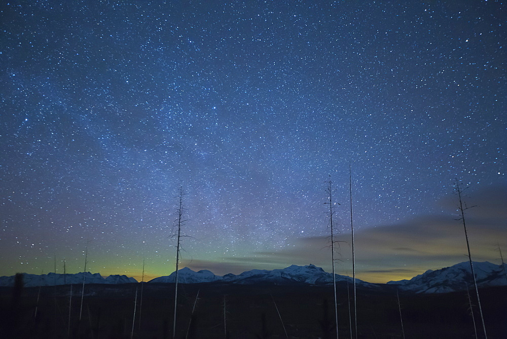 Scenic view of night sky with aurora borealis, Glacier National Park, Montana, USA