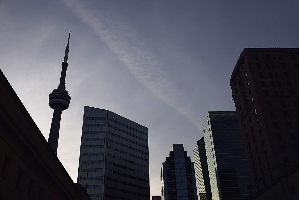 Low angle view of city architecture and communications tower, Toronto, Canada