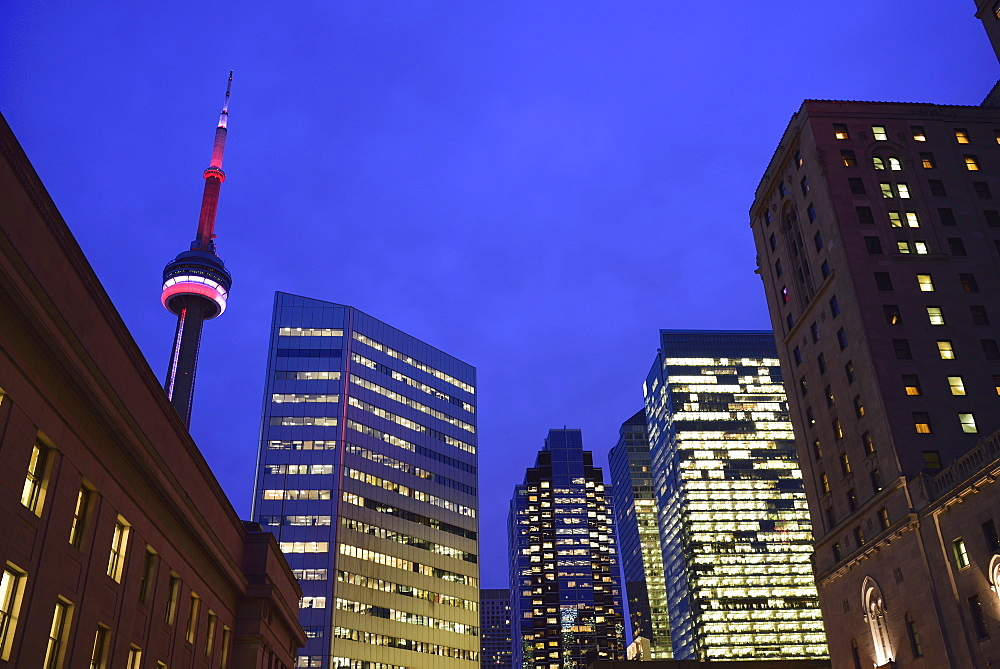 Illuminated city at dusk and CN Tower, Toronto, Canada