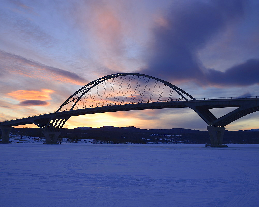 Lake Champlain Bridge linking New York and Vermont over a frozen Lake Champlain at Crown Point, snowed landscape at dusk, Crown Point, New York